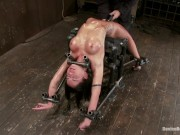 brunette with rocking body in hard metal bondage 1