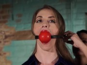 Pretty woman is tied and ball & tape gagged