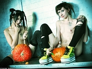Two pale gothic sluts with tiny tits carving pumpkins